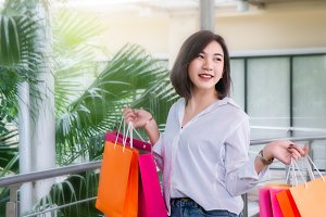 woman hold shopping bags on the day
