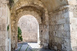 Old stone passage in stone wall