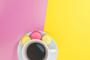 Flat lay of coffee cup with macaroon