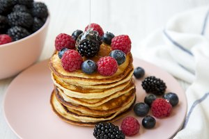 Pancakes with berries and honey