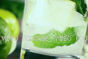 Slow motion pour soda into a glass