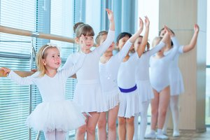 Young ballerinas rehearsing in the