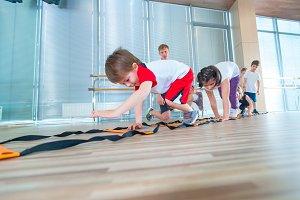 Happy sporty children in gym. Kids