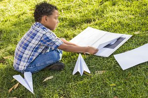 Mixed Race Boy Learning How to Fold