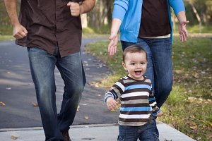 Happy Mixed Race Ethnic Family Walki