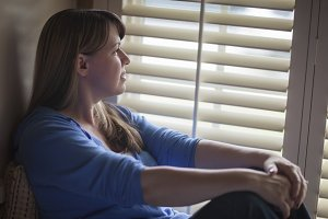 Pensive Woman Sitting Near Window Sh