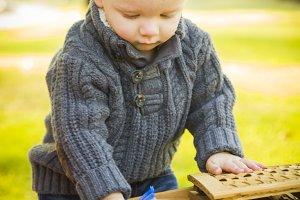 Blonde Baby Boy Opening Picnic Baske