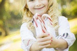 Cute Little Girl Holding Christmas C
