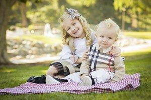 Sweet Little Girl Hugs Her Baby Brot