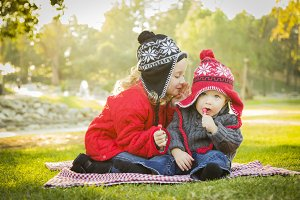 Little Girl Whispers A Secret to Bab