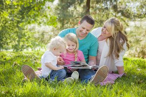 Young Family Enjoys Reading a Book i