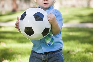 Young Cute Boy Playing with Soccer B