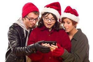 Three Friends Enjoying A Cell Phone