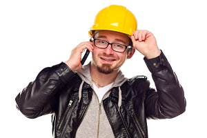 Handsome Young Man in Hard Hat on Ph
