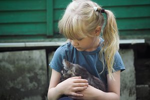 Portrait of a child with a kitten