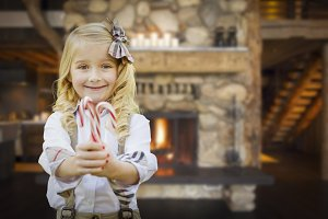 Cute Young Girl Holding Candy Canes