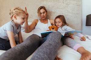 Mother reading bedtime story