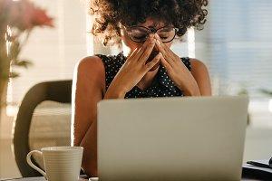 Stressed businesswoman sitting