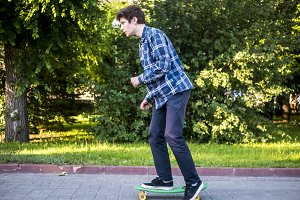 side view of young man riding skateb