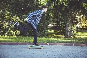 young hipster riding a penny board s
