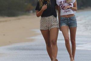Two Blonde Females Walking on Beach
