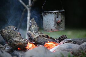 Boiling Water Over Campfire