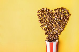 Sweet chocolate popcorn in paper str