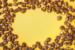 Frame of chocolate popcorn on a yell