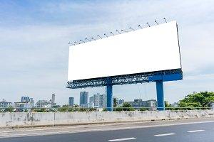 billboard blank on road in city for