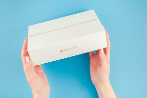 Woman hands with the box of Apple iP