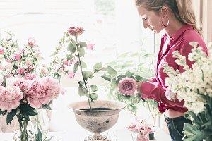 Florist women make roses bouquet