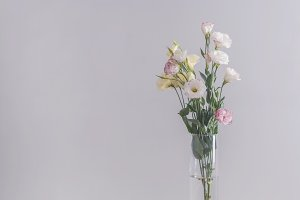Eustoma flowers bouquet in a vase on