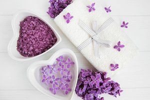 Spa towel and lilac flowers