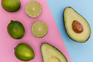 Avocado half on pink background