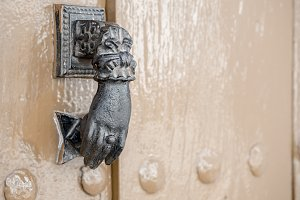 Old metal knocker on a door