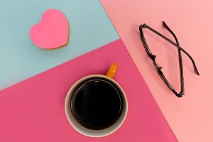 Coffee cup and love heart on pink