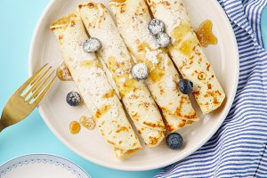 Rolled pancakes with berry filling