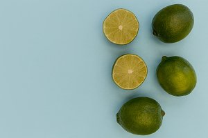 Fresh lime fruits on blue background