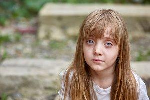 Portrait of sad vulnerable little