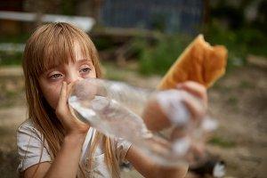 Portrait of poor homeless girl