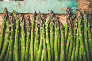 Raw uncooked green asparagus over