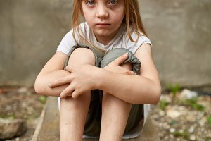 Street photo of girl orphan in dirty