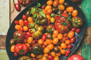 Flat -lay of fresh colorful tomatoes