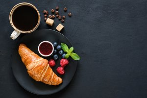 Croissant with berries, jam, coffee
