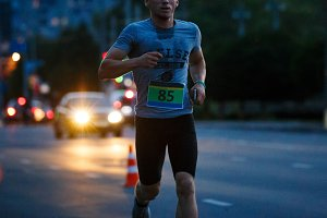 Young man running in night run