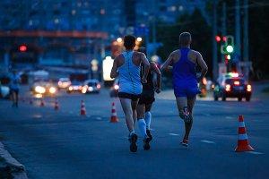 Group of sportsmen running on night