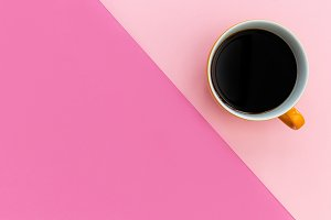 Coffee cup minimal pink background