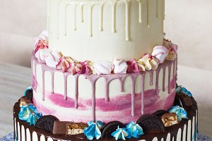 Three-tiered colored cake with
