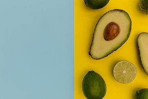 Avocado half on yellow background