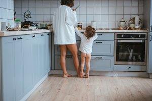 Mom and daughter preparing breakfast
